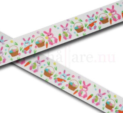 Band 22 mm, vit med påskharar i rosa, lila och blå