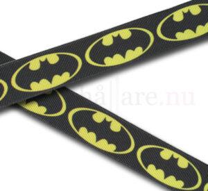 Batman-band 22 mm, mörkgrå med gula Batman-loggor till napphållare/nappband.